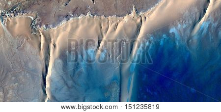 Caribbean beaches with turquoise waters in the middle of african desert from the air,mirage in the Sahara, abstract photography naturalist from the deserts of Africa,waves,sea and sand in the dunes,