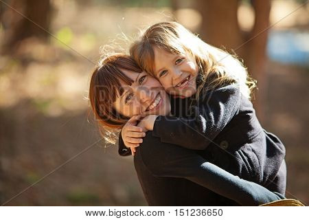 A Woman Holds Her Daughter In Her Arms