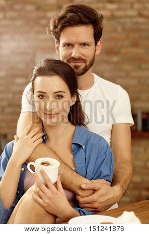 Portrait of loving couple embracing in the morning.