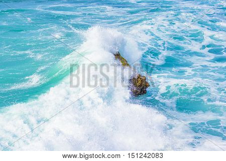 Wave Hitting A Rock