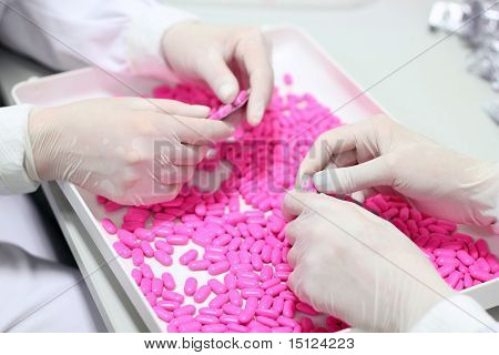 Hands Holding Pills - Quality Control