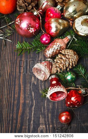 Vintage Christmas ornaments tree branches and other decorations on the wooden background. New Year background. The concept of the winter holidays.