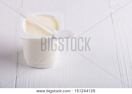 Creamy yogurt. Greek yogurt. Yogurt in white plastic cup.