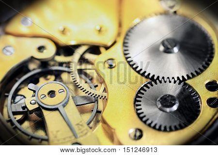 Old pocket watch inside in golden color with vignette