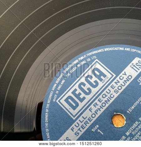 London, England - October 11, 2016: Close up of a vinyl record or long playing album with the Decca Records music label, founded in London in 1929