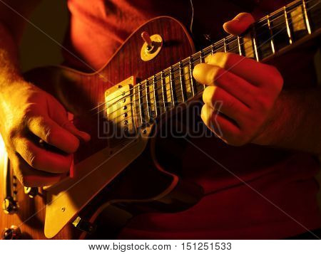 Guitarist plays the electric guitar