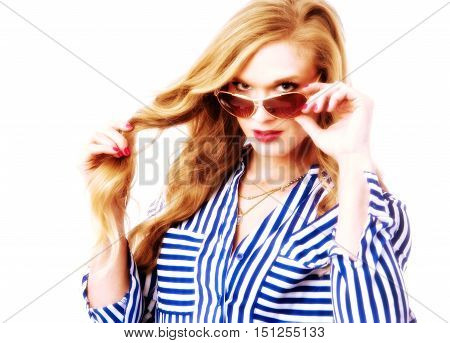 Model with sunglasses dressed for summer in blue top and jeans