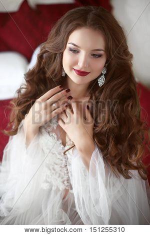 Beautiful Smiling Bride Woman. Wedding Makeup. Attractive Young Girl Model With Long Wavy Hair Weari