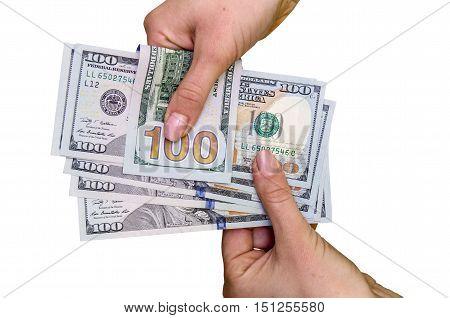 female hand holding new one hundred dollar bill