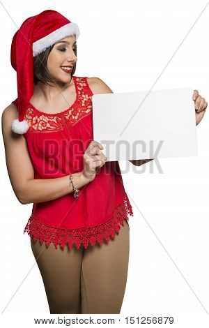 Holidays, Christmas. Portrait Of Smiling Woman Wearing Santa Hat Showing Whiteboard Banner Over Whit