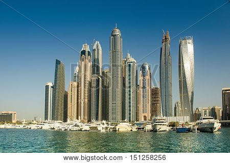 DUBAI, UAE - OCTOBER 09, 2016.  View of Infinity tower and other Dubai Marina skyscrapers with stunning turquoise waters as foreground