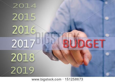 bussinessman hand pointing budget text for 2017. targets concept
