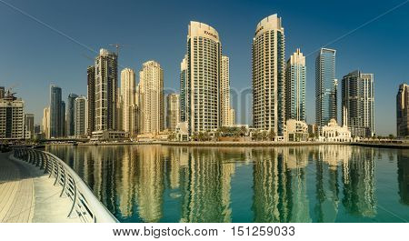 DUBAI, UAE - OCTOBER 09, 2016.  View of skyscrapers in Dubai marina with skyscrapers from the Marina Walk with reflections