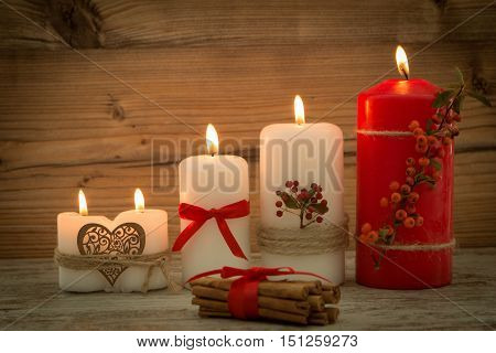 Elegant candles decorated for Christmas. Brighten up your illusion