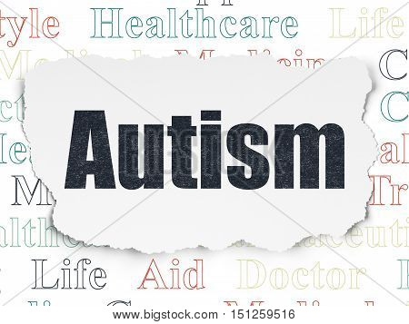 Health concept: Painted black text Autism on Torn Paper background with  Tag Cloud