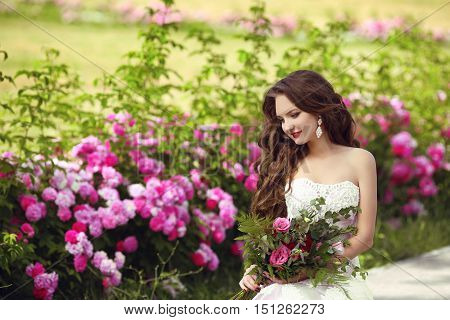 Beautiful Brunette Bride Outdoor Portrait. Woman With Wedding Bouquet Of Flowers At Green Park. Make