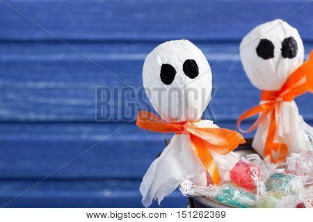 Halloween lollipop ghosts and candies on purple wooden backround horizontal orientation