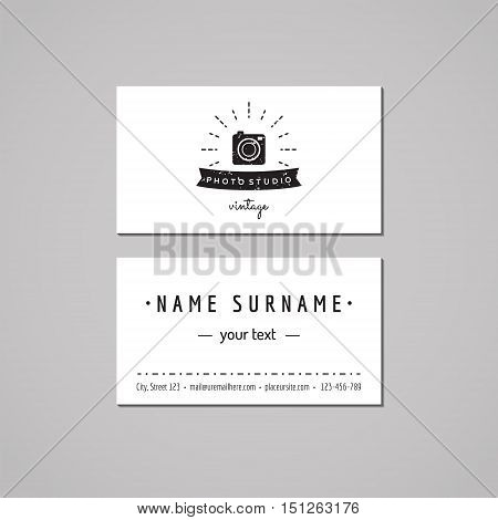 Photo studio business card design concept. Logo with photo camera rays and ribbon. Vintage hipster and retro style. Black and white.