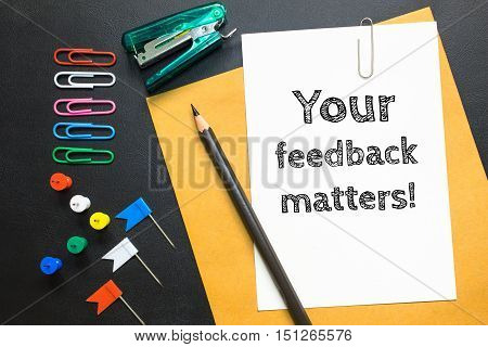 Text your feedback matters on white paper background / business concept