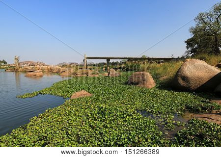 Tungabhadra river near ancient Hampi ruins Hampi India.
