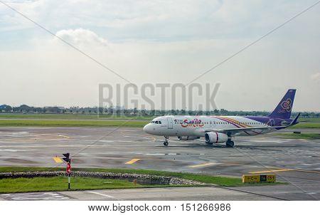 BANGKOK THAILANDAUGUST 25: Thai smile Airways airplane in movement in runway at Suvarnabhumi airport in Bangkok on August 25 2016
