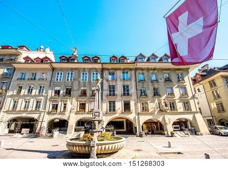 Buildings on Kramgasse with fountain in the old town of Bern city. It is a popular shopping street and medieval city centre of Bern, Switzerland