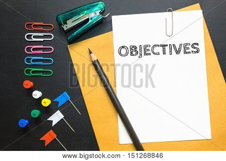 Word text Objectives on white paper background - business concept