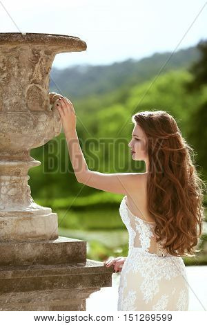 Bride. Wedding Outdoor Portrait Of Gorgeous Brunette Bride With Long Wavy Hair Wearing In White Fash