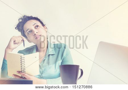 Thoughtful Black Woman With Notebook