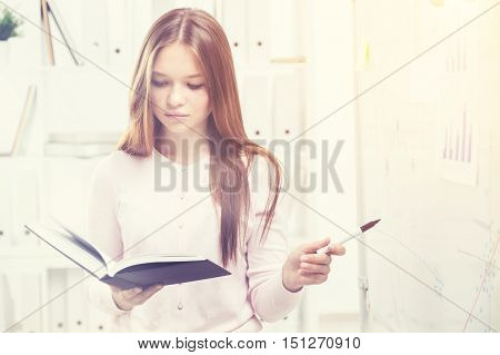 Woman Reading A Book In Office
