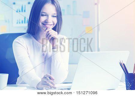 Smiling Woman Using Her Laptop