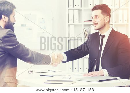 Businesspeople Shaking Hands And Smiling