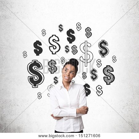 Smiling African American girl standing near concrete wall with dollar signs on it. Concept of making up new ways to earn money