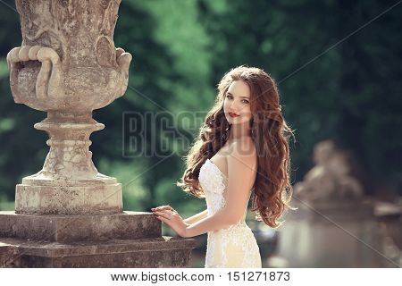 Bride. Wedding Outdoor Portrait Of Gorgeous Brunette Woman With Long Wavy Hair Wearing In White Fash