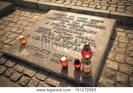 OSWIECIM POLAND - MAY 12 2016: Tombstone commemorating the victims in concentration camp Auschwitz Birkenau II in Brzezinka Poland.