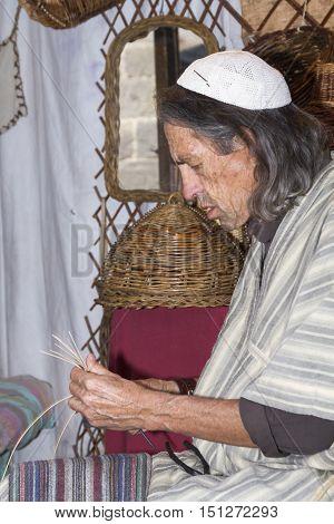 Avila, Spain - September 03, 2016 exhibition of a wicker craftsman in a medieval market