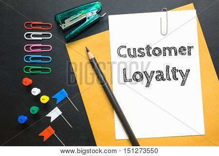 Text Customer loyalty on white paper background / business concept