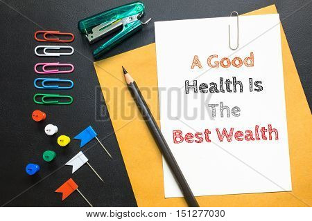 Text A good health is the best wealth on white paper / health care concept