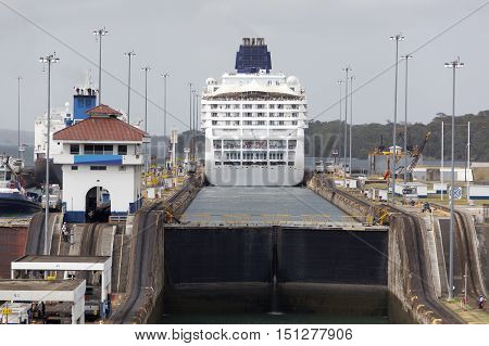 The cruise liner leaving one of canal locks and entering artificial lake (Panama).