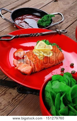 delicious portion of fresh roast salmon fillet red plate green salad kale tomato soup bbq sauce black coffee wooden table - healthy food, diet cooking concept  healthy food