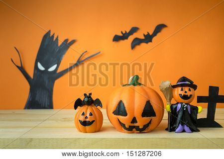 Halloween Pumpkins on wooden table, treat, trick
