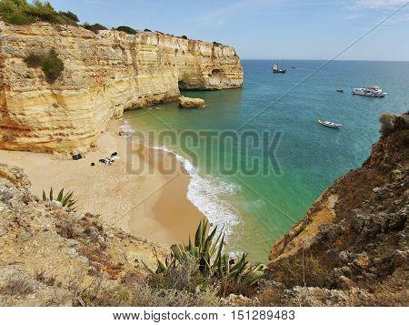 Beach and wild rocky coast in Portugal in the Algarve