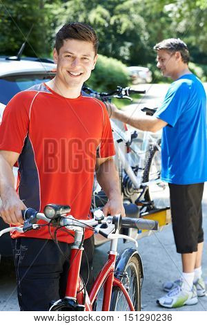 Two Men Going On Cycle Ride Together