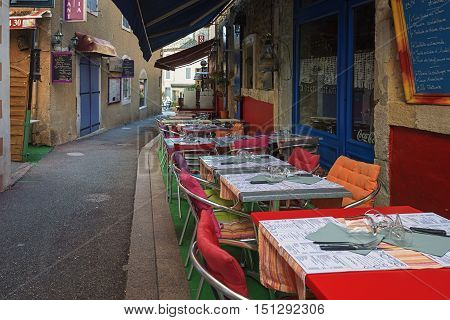 Valon Pont d'Arc France - September 19 2016: Narrow street with restaurants in the old town of Vallon Pont d'Arc Ardeche in France.
