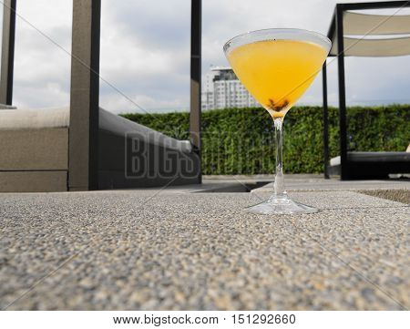 orange cocktail with pool view background - soft and select focus