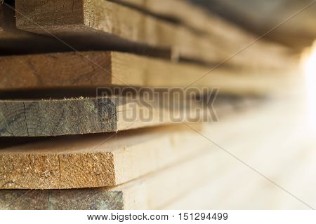 Stack of new wooden studs at the lumber yard. Wood timber construction material.