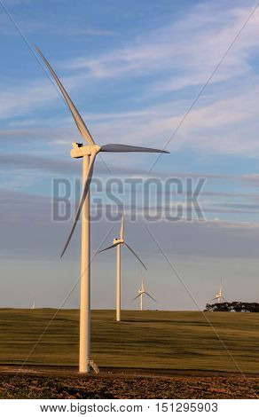 Wind turbines turning in the wind generating electricity