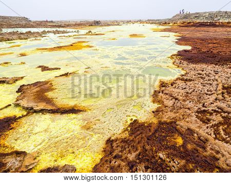 Sulphur lake Dallol in a volcanic explosion crater in the Danakil Depression northeast of the Erta Ale Range in Ethiopia. The lake with its sulphur springs is the hottest place on Earth.
