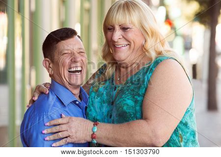 Laughing Transgender Couple Outside