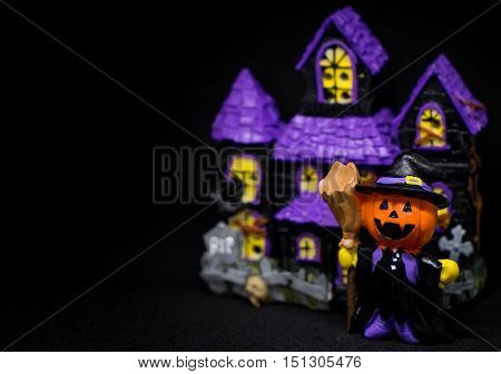 Halloween Pumpkins Ghost with purple house copy space